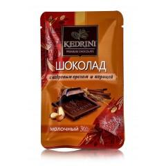Шоколад Kedrini молочный с кедровым орехом и корицей, 23 г
